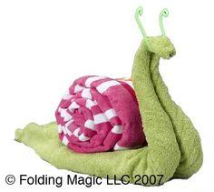 snail towel origami Learn to make them here: http://FoldingMagic.com