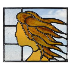 Autumn - Female figure with flowing tresses. Designed and made by Radiance Stained Glass.