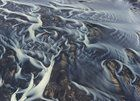 """Submitted by  on Reddit. """"This image is aerial photo of glacial river in Iceland. The river divided into a great number of interlinked streams and flows"""" writes photographer Andre Ermolaev. [2000 x 1446]"""