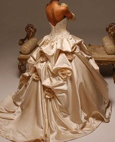 .HACK: Gather up wedding dress @ various points, attach silk flowers with safety pins.