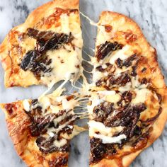Short Rib Pizza with Smoked Gouda Cream Sauce and Caramelized Onions