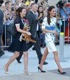 Private Secretary Rebecca Deacon carries a stuffed Kangaroo as Catherine, Duchess of Cambridge as she does a walkabout on the South Bank on April 19, 2014 in Brisbane,