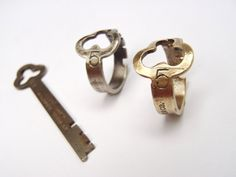 """This dainty ring is an exact historic reproduction of a National Cash Register printer door key (c.1915).  Back in those days, each register took 5 or 6 different keys to open and operate different parts of the machine. This key (#5) opened the printer door on the right side of the register, where a thin roll of paper was used to print receipts. This is one of my favorite ring styles in the shop because of its thin stem (3/16"""" wide), clear engraving, and fascinating history."""