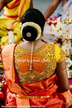 Our client Vandana opts for a traditional hair bun style for her child's namakarana. Silk Saree. Gold jewellery. Maang tikka. Saree blouse design. Hairstyle. Find us https://www.facebook.com/SwankStudioBangalore