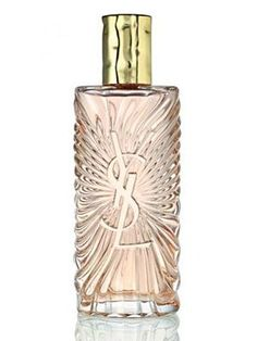 """Saharienne Yves Saint Laurent perfume - a fragrance for women 2011. The perfume composition blends the contrasts of hot desert aromas and fresh tones that are desirable in the summer as """"the hottest of all fresh waters"""". Sparkling and invigorating notes of lemon, Italian bergamot and mandarin give way to the core made of white flower petals, orange leaf, galbanum and black currant bud. The base is warm and sensual due to the spiciness of pink pepper and ginger."""