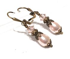 A personal favorite from my Etsy shop https://www.etsy.com/listing/573095579/vintage-pink-simulated-pearl-earrings