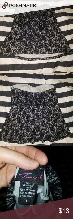 Torrid Strapless Lace Top Super pretty strapless top from Torrid. The shirt features a sweetheart neckline and black lace over gray underlay. The slightly flared body makes this top very flattering. The bra section is lightly lined and the back is elastic/stretchy. I received this from a friend but it's too big for me so my loss is your gain!  Smoke-free, pet friendly home. I am open to offers!! Torrid Tops