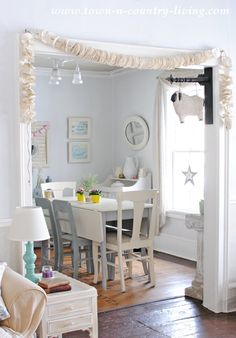 Rather than throw an unwanted book into the garbage, why not recycle it into something beautiful like a book page garland? See how easy it is to make! Bunting Garland, Buntings, Town And Country, Country Living, Book Page Garland, Book Page Crafts, Class Decoration, Craft Ideas, Decor Ideas