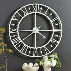 DINING ROOM:  Chateau Betton Clock for an accent wall of black and white photographs.