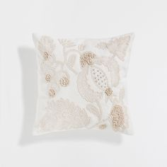 CUSHION WITH EMBROIDERED LEAVES
