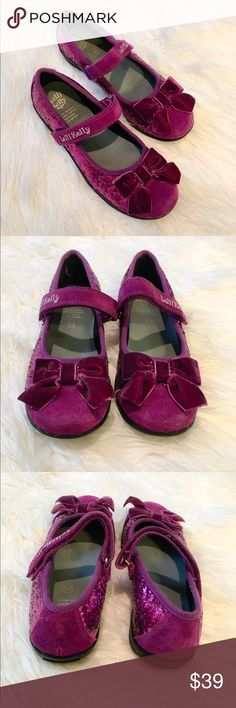Girls Lelli Kelly suede glitter Mary Janes Girls suede and glitter Mary Jane shoes with a sweet velvet bow. Has traction soles so you can dress these shoes up, but will also allow your little girl to run and play. Gently worn, excellent condition. Lots of miles left in these. My girl only wore them a handful of times. European size 33 is a 2 1/2 according to charts online. Lelli Kelly Kids Shoes Dress Shoes