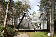 Adding 290 square feet to this already small (just 566 square feet) black A-frame in Brecht, Belgium, was all the local building ordinances allowed, but the architects at dmvA found that a single wing extended out to the side gave resident Rini van Beek all the storage and living space that she needs.  Photo by: Frederik Vercruysse | Dwell