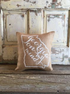 Burlap pillow with Georgia on my mind lyrics lovingly hand painted inside an outline of our state! Hand painted white on natural burlap. Pillow