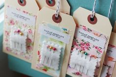 nanaCompany  DIY handmade tags (manilla tags, fabric swatch, wool felt, needles, and a paper label, all sewn together)