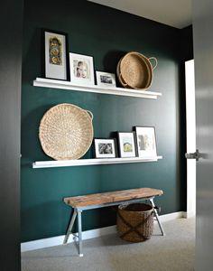 very dark intense emerald wall with white shelves