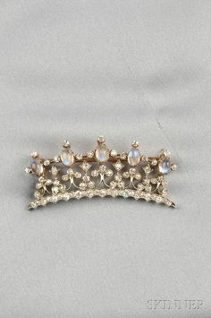 Edwardian Moonstone and Diamond Crown Brooch, set with five cabochon moonstones and old mine-cut diamonds, approx. total diamond wt. 3.00 cts., platinum-topped 14kt gold mount, lg. 2 1/8 in.