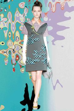 """PRADA FW15 - MilanCandy-coated acid puff – """"Volatile Serenity"""" by Shirley Kaneda, jeweled embroidery, waterproof fabric, """"Glyph~Garland Resonator"""" by Brenna Murphy, """"Paris Series"""" by Edward Clark, edible arrangements bouquet, """"Untitled"""" by Laura Owens."""