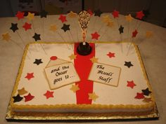 Teacher Appreciation Sheet Cake - An Oscar themed sheet cake for a local elementary school celebrating Teacher Appreciation Week. One 11x15 is chocolate the other 11x15 is yellow. All iced in buttercream. The stars, envelope, and card are all gum paste. Red carpet is fondant. Plastic statuette.