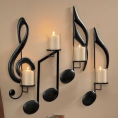"Each candleholder has a spike for a 2"" pillar candle not included. Black painted metal.Set includes2 single notes 8 1/4"" w x 20"" h x 5 1/4"" d each1 double note 9 1/2"" w x 16"" h x 20"" h1 G clef 7"" w x 20"" h x 5 1/4"" d4 glass hurricanes 3 1/2"" diam. x 4"" hAvailable only in black.."
