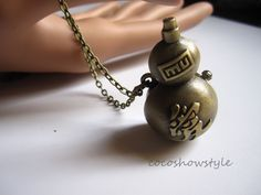 """Vintage Naruto Garra's Sand Gourd pocket watch with Chinese Word""""Love' Necklace. $4.99, via Etsy."""