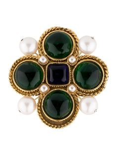 From the Season 25 Collection. Textured gold-tone Chanel brooch with green and blue gripoix embellishments featuring faux pearl accents and pin closure.