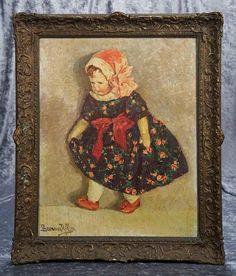 """24"""" x 19"""" framed. A first series Kathe Kruse doll in flowered dress with shell-coral cap and shoes is featured in the impressionistic style painting, in frame. Signed on lower left. Early 20th century. Excellent condition."""