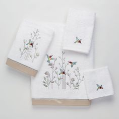 croscill jasmin towels in ivory embellished with a band of crinkled faux silk fabric at the hem further embellished by a row of flu2026