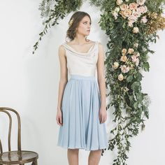 In love with our Vintage Gold cowl neck MANDY top and GINA skirt in dusty blue combine to make this gorgeous look for your maids 🎇 Available in lots of other lovely colours too ♡ We ship worldwide ♡  .  .  #loveyourmaids #nzweddings #madeinnewzealand #bridesmaids #bridesmaidfashion #bridesmaidinspiration #wearagain #dresses #weddinginspiration #bridalfashion #fashion #opulentdreamer #draped #madetoorder #gown #shipworldwide #mattgold #dustyblue