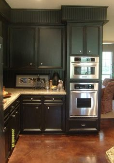 AFTER #2: closely check out the black painted beadboarded soffit and backsplash - Genius idea !!!!