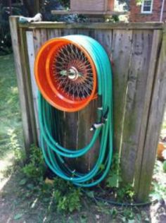 Upcycle Tire Rim to Water Hose Holder. You could even make it to where it spins so you can wind it up!