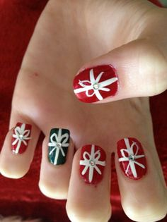 Turn your nails into Christmas gifts with this ribbon themed nail art design. You can use Christmas colors such as green and red for the wrappers and add white ribbons on top to complete the effect.
