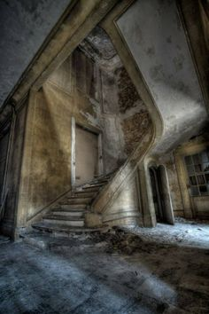 A once grand staircase in an abandoned office building in Luxembourg.