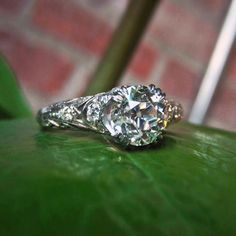 How to build a beautiful Art Deco engagement ring… Start with a perfect Old European cut diamond, check. Architectural filigree, check. More Old European cuts scattered throughout for serious sparkle, check. Looks elegant on the hand, check and mate! All in platinum, circa 1920. #doyleanddoyle #doyledoylerings #artdecodiamondring #vintageengagementring #oldeuropeancut