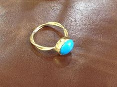 Turquoise Jewelry Ring This turquoise beauty reminds me of the clear, Mediterranean waters and looks absolutely breathtaking perched atop this 18 karat gold band. Would make a beautiful engagement ring or Mother's Day gift! Geek Engagement Rings, Beautiful Engagement Rings, Miss You Gifts, Handmade Rings, Handmade Jewelry, Gold Bands, Turquoise Jewelry, Mother Day Gifts, Jewelry Rings