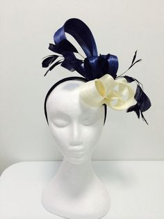 Abaca Silk with feather detail....Kellie Batley Millinery