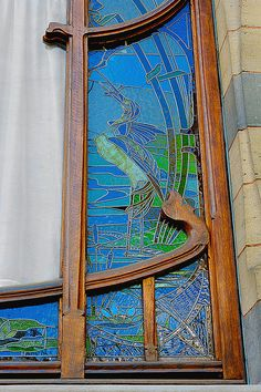 """Art Nouveau window. Brussels is the capital of Art Nouveau and magnificent structures throughout the capital city are recognized as """"world heritage"""" by UNESCO."""