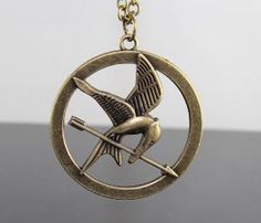 The Hunger Games Logo pendant Inspired Mockingjay by BeautyandLuck