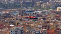 Watch a Ferrari F1 car fly over Barcelona. This new-fangled Formula 1 tech is really something. - Road & Track