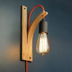 Wall light features a curved wooden bracket steam-formed into shape from a single piece of wood. Wood is sourced locally from sustainable English woodlands. Wood bracket type- English Ash, English Oak, English Elm and American Black Walnut Lampholder - Brass, Chrome or Black (screws will match these) Cable colour - Forest Green, Sky Blue, Matt Orange, Black, White, Grey (other colours available on request) Each light bracket comes with screws and wall plugs for easy fixing. The cable is…