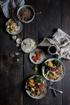 warm grain bowl with quinoa, roasted cauliflower, & spicy chicken   two red bowls