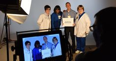 "by Karen Stewart                                                                                        Christian Hospital nurses enjoying making ""The Power of Nursing"" video in the BJC media services studio. From left are Tommi Cline, RN, MSN, patient care manager;  Kimberly Clark, RN, BA, patient care manager; Jim Cadle, RN, emergency department clinical supervisor; and Maria St. George, RN, hospital supervisor. 