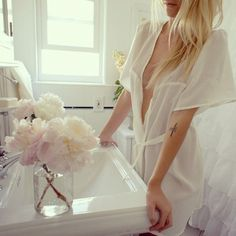 Peonies, all-white, a mason jar, a robe—I don't think this could get better