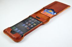 truffol.com | Category: Masculine. This iPhone 5 case doubles as a leather wallet and card holder. Most men would love to combine their phone and wallet to give them more pocket space. The leather texture and color is very popular when it comes to wallet, so why not put it on your phone?