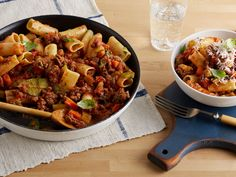 Simple Bolognese : Giada De Laurentiis' meaty pasta sauce is made all in one pot. Be sure to break up any large clumps when sauteing to fully incorporate the meat with the tomatoes, basil and parsley.