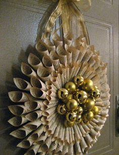 Decorate for the holidays with a paper wreath! The Beautiful Rolled Book Page Wreath is a gorgeous decoration for your home. This craft is an upcycling project, so you can craft an old vintage book from your basement or the thrift store.