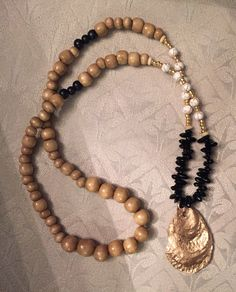 Gold oyster shell necklace by Carolinapearlz on Etsy