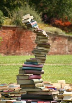Would love to have an artificial book tower stack like this, as well as stepping stones that look like books