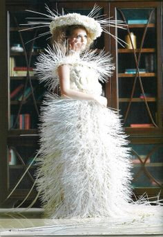 """Petals & Plastic"" More than 12,000 white plastic cable ties.  it had a long train.  Magnolia & gerbera petals on hat & bodice."