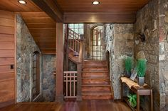 A combination of wood and rock in this front entry and staircase Log Cabin Designs, Timber House, Timber Frame Homes, Timber Frames, Ranch Decor, House In The Woods, Mountain Homes, Stone Walls, Wood Stone