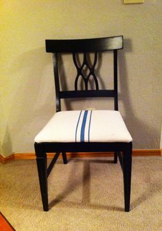 Hand painted grain sack seat cover using painters drop cloth and fabric paint.
